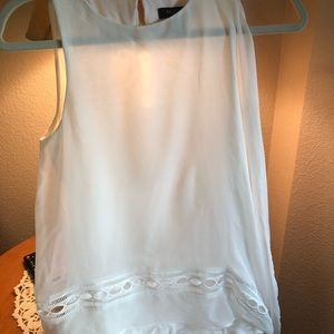 Ivory layered tunic shell blouse on the side
